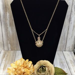Gold Metal  Ethnic Chain and Jar Pendent Necklace